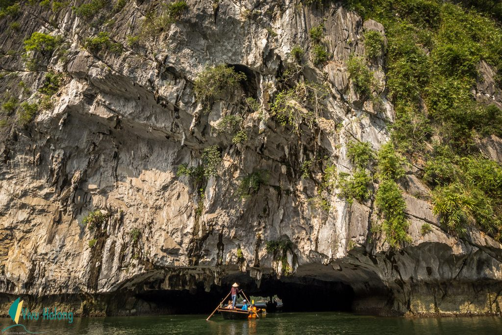 Local bamboo boat to visit Bright and Dark cave